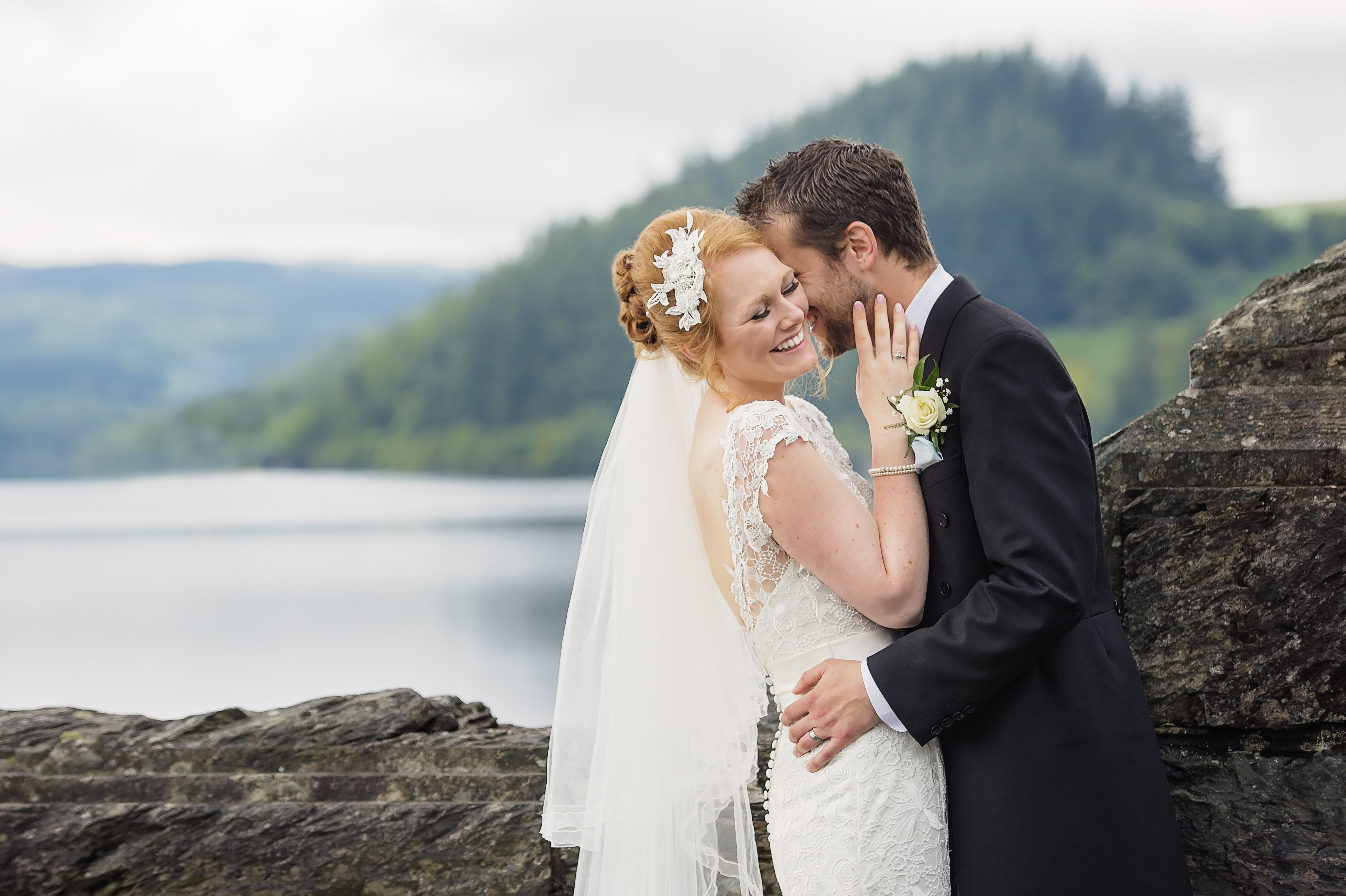 Natural and romantic bride and groom photo in front of Lake Vyrnwy, Wales
