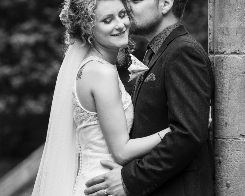 Groom nuzzles into brides face for beautiful romantic photos