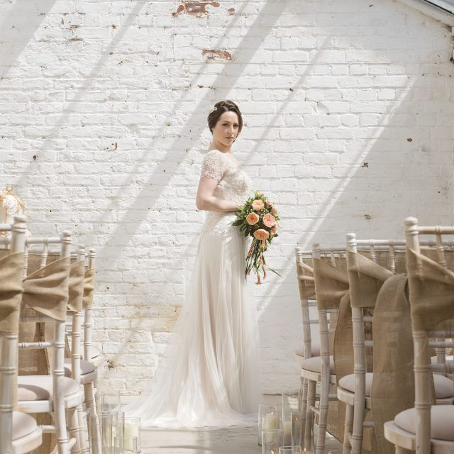 bride photographed at rustic wedding ceremony set up