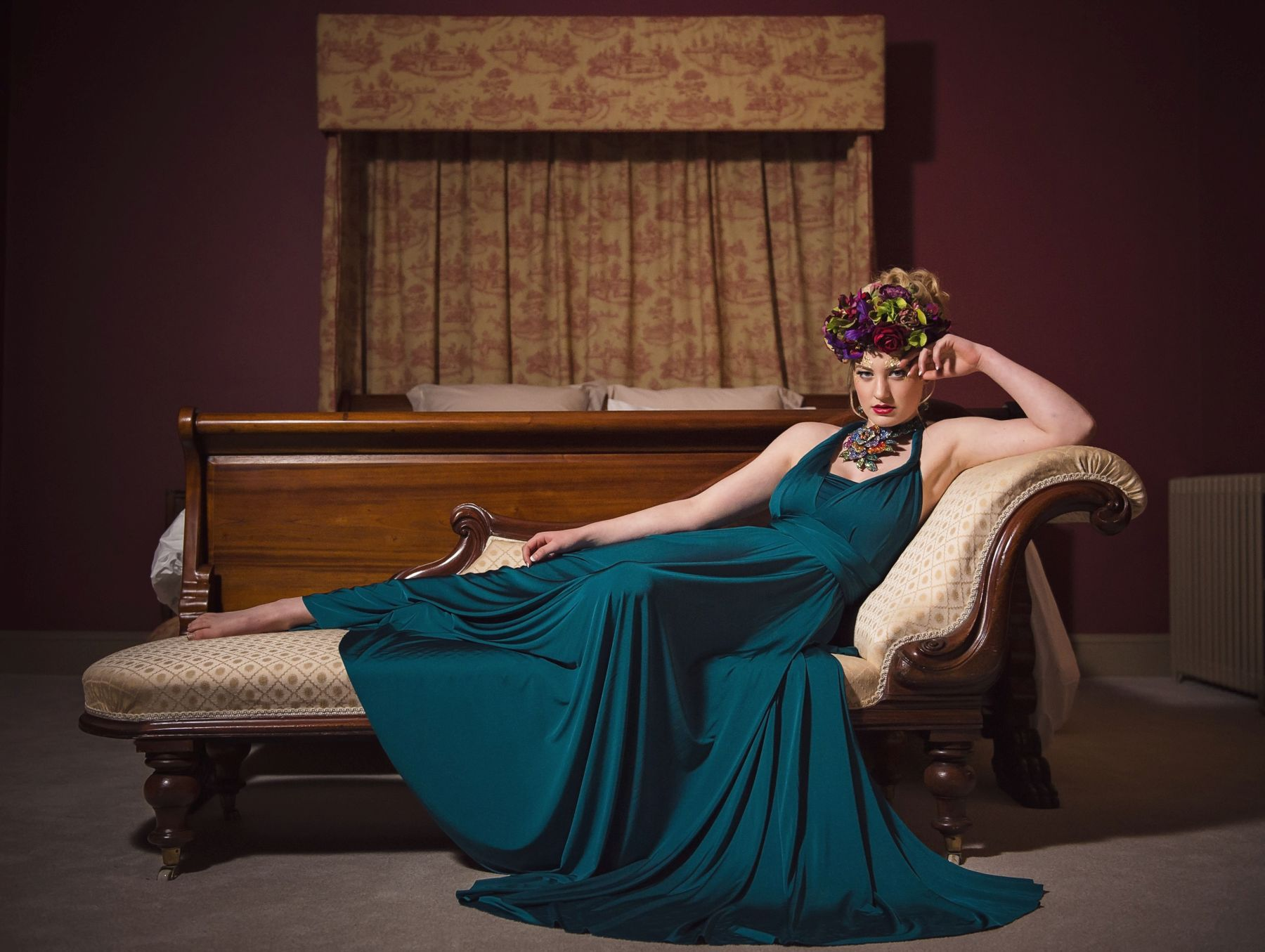 Editorial fashion photo with bridal floral crown and two birds gown