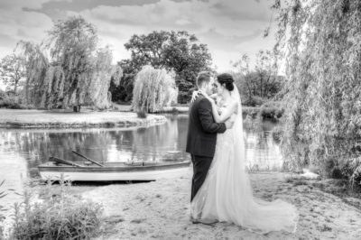 Award Winning Wedding Image of bride and groom by lake