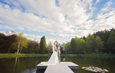 Award winning image of bride and groom on a jetty by the water