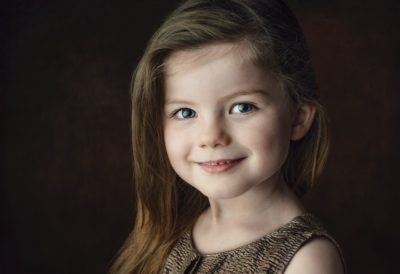 Silver award winning fine art studio portrait of happy smiling and beautiful 5 year old girl