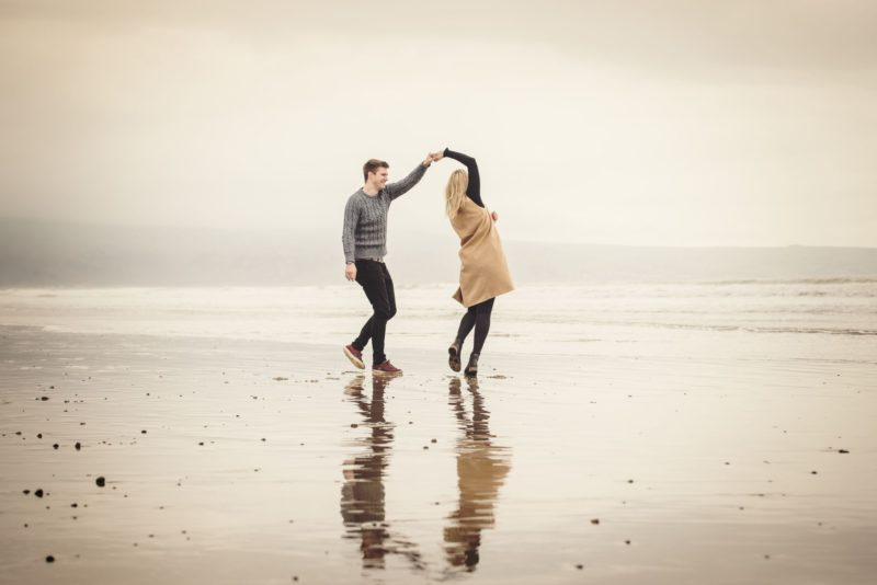 Man and wife to be dance on the beach